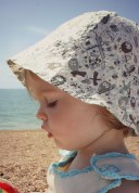 girl in sunhat on beach